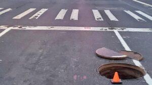 manhole cover left open